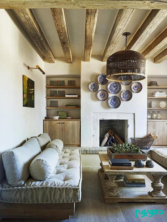 Big-tufted-cushion-seats-with-wooden-table-also-unique-hanging-lamp-and-concrete-fireplace-design-in-the-living-room