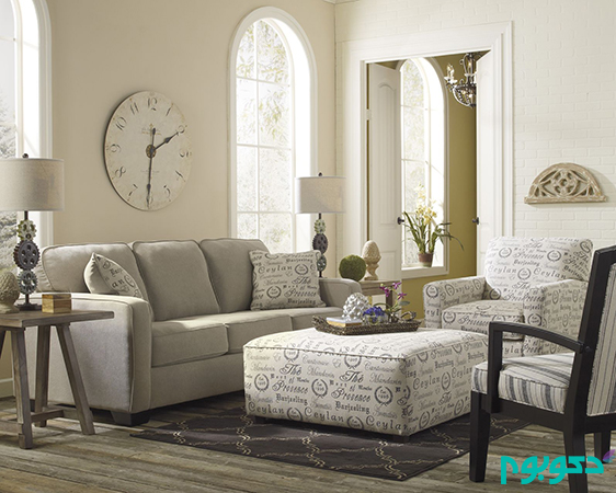 Small-Space-Neutral-Living-Room-with-Gray-Fabric-Three-Seater-Sofa-and-White-Ottoman-Table-also-White-Wood-Dom-Shaped-Window-Frame