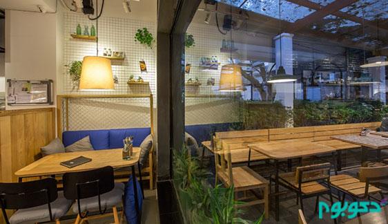 فضای سبز و دلباز در طراحی مدرن این کافی شاپ